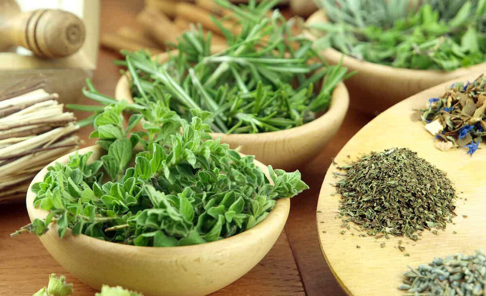dried oregano and thyme in bowls